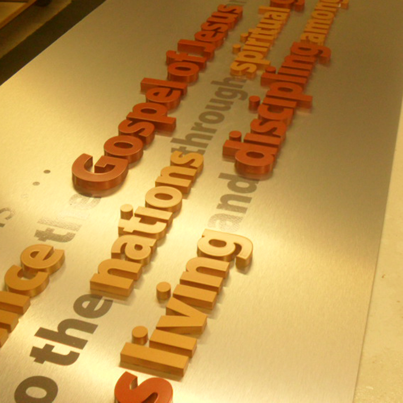 Navigators Custom Wall lettering 12 foot display with vinyl and 3D lettering in different colors and sizes hung with 2 inch standoffs