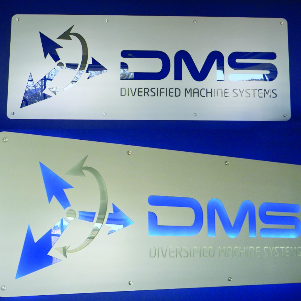 DMS backlit LED lit logo cut into steel and hung with 2 inch standoffs.